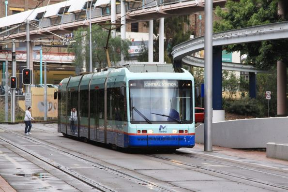Central bound Variotram 2104 enters section of street running at Paddy's Market