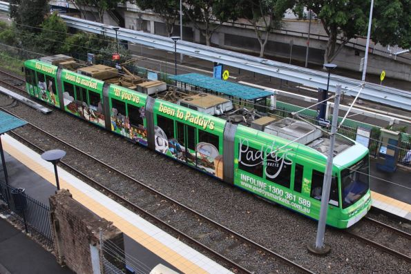 Variotram 2107 in 'Paddy's Market' livery stops for passengers at Convention
