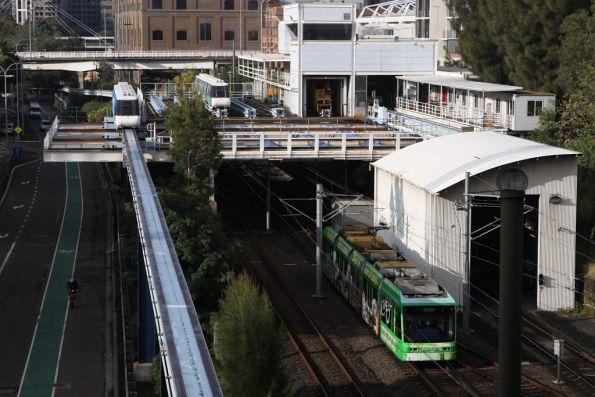 Lilyfield bound Variotram 2107 passes beneath the Sydney Monorail depot at Ultimo