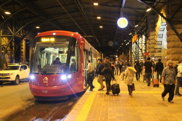 Passengers board Urbos 3 tram 2124 at Central Station