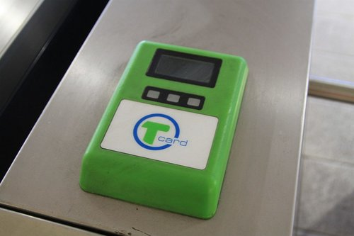 Forgotten Tcard reader mounted on a turnstile at Chinatown station