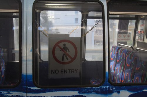 'No entry' sign in a monorail carriage locked off due to defective doors