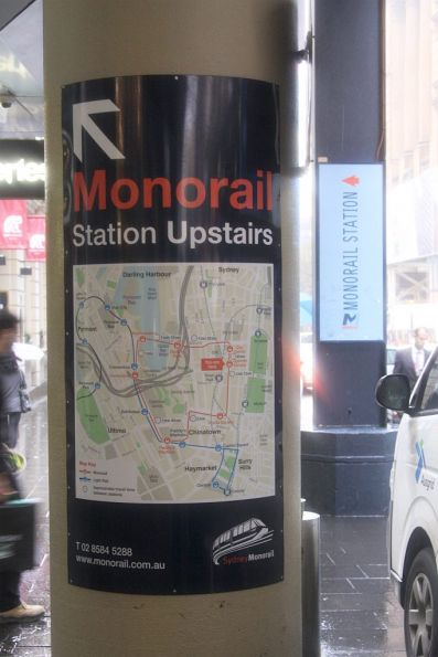 Two types of monorail signs: older 'Sydney Monorail' and the current 'Metro Monorail'