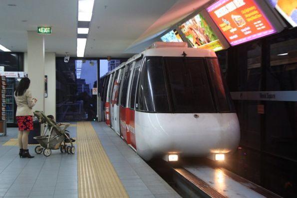 Monorail train arrives into World Square station