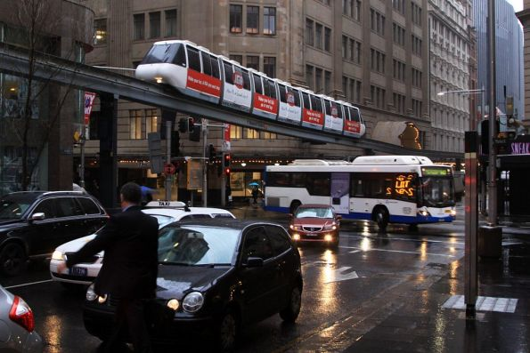 Busy on the roads for morning peak, the Sydney Monorail glides past overhead