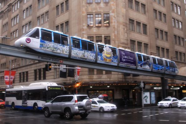 Set 6 advertising 'Sydney Tower Eye' above George and Market Street