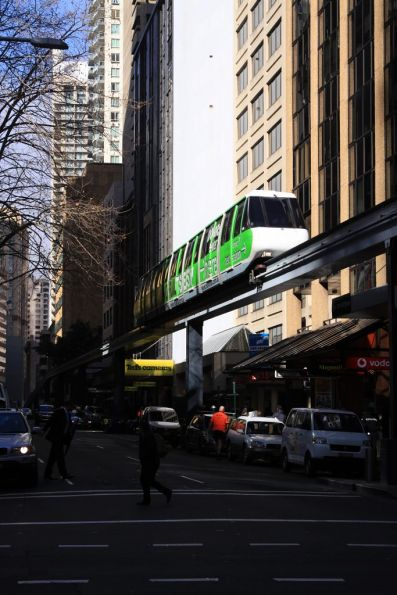 Set 4 in a promotional Metro Monorail livery heads along Pitt Street