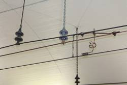 Overhead wires hanging from the tunnel roof at Museum station