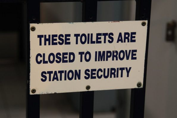 'These toilets are closed to improve station security' sign at a staffed CityRail station