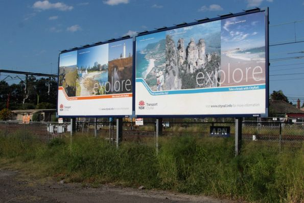 CityRail tourism advertising beside the Illawarra line at Tempe