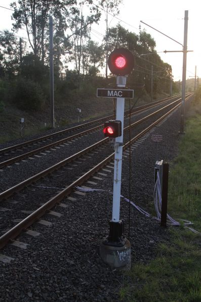 Signal fixed at stop at the down end of Macarthur station on the up track