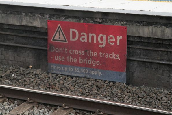 'Don't cross the trains' sign at Lidcombe station