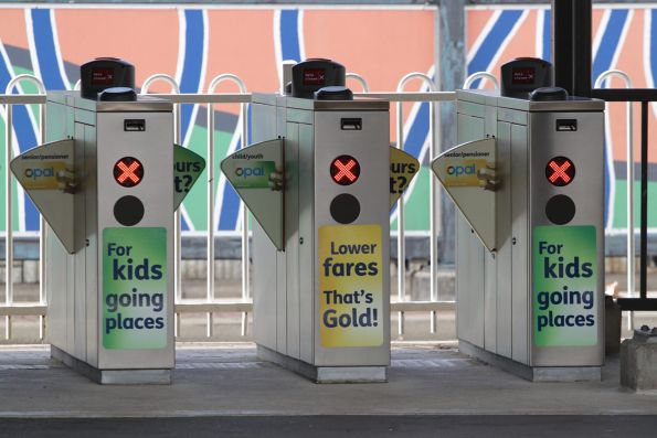 Ticket gates with Opal promotional stickers affixed