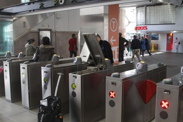 Magstripe equipment under repair inside the ticket barriers at Circular Quay station