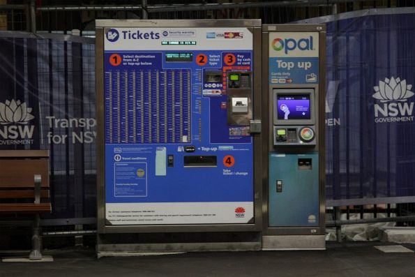 Older style ticket machine beside a newer Opal card top up machine