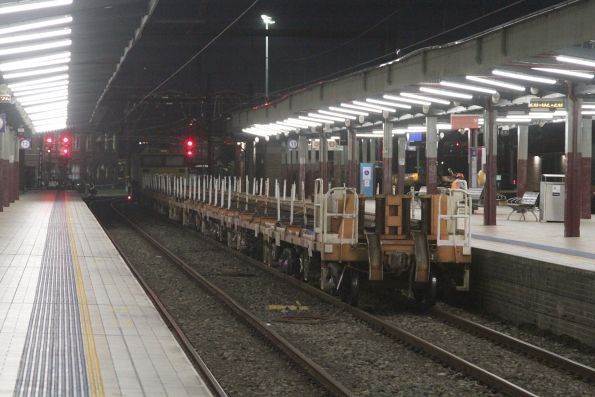 Rail discharge train stabled behind an 81 class locomotive at Sydney Central platform 11