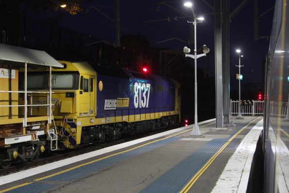 8137 at the down end of a ballast train at Redfern station