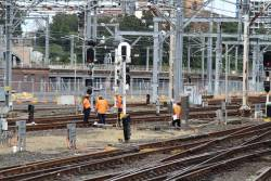 Workers inspect the track at Sydney Yard
