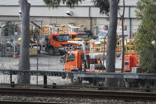 Sydney Trains overhead maintenance trucks stabled in the yard at Strathfield