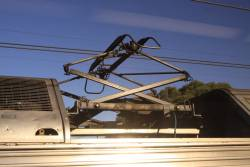 Double arm pantograph of a silver set running along double contact wires