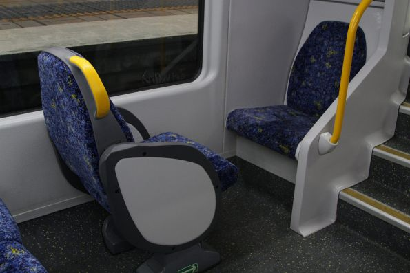 Two solo seats on the lower deck of a Waratah train