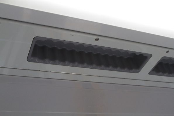 Ceiling mounted grabholds above the doorway of a Waratah train