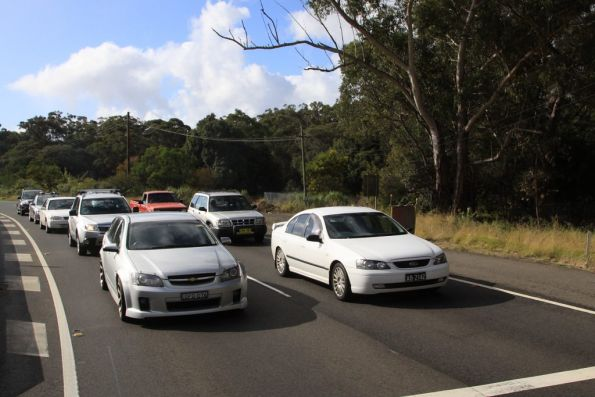 Road traffic on the Princes Highway stopped for the tram crossing