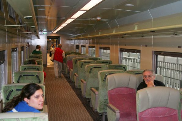 Looking down a first class / 'Red Premium' carriage
