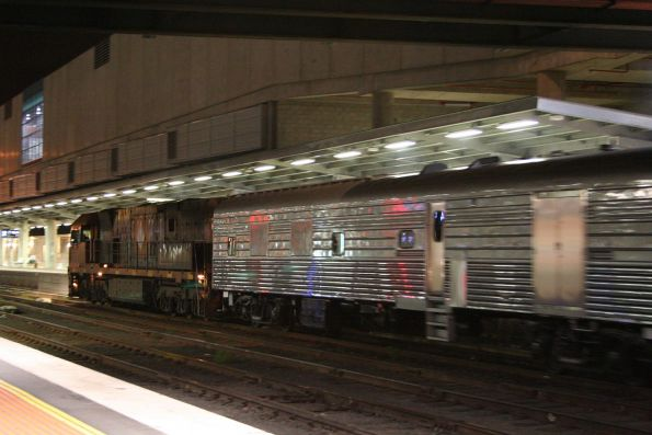 NR121 departs Southern Cross bound for Dynon with the refurbished Overland set
