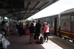 Passengers collect their luggage at Townsville