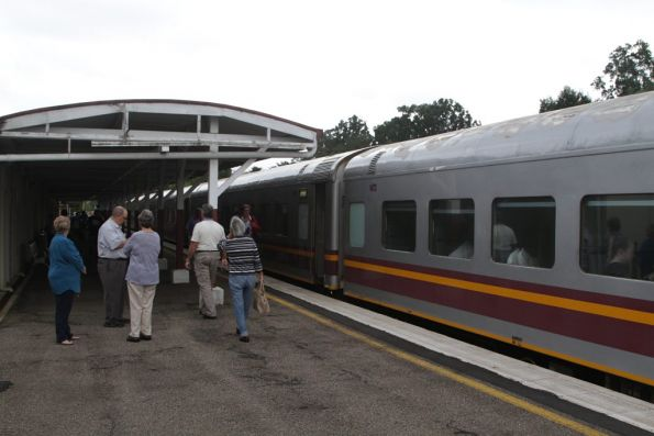 Passengers stretch their legs during the station stop at Tully