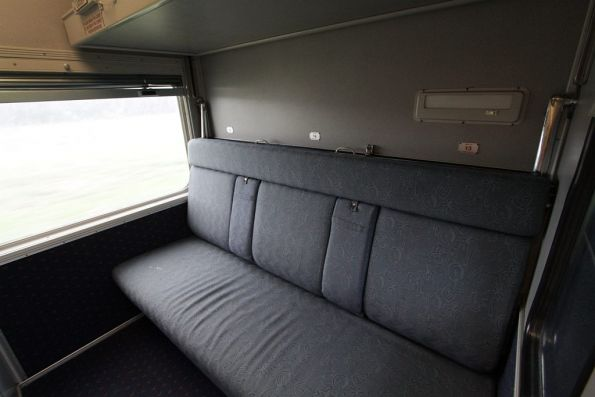 Day seating onboard a triple-berth MBS sleeping carriage