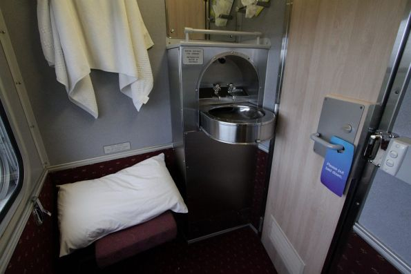 Washbasin and visitors seat inside a roomette carriage