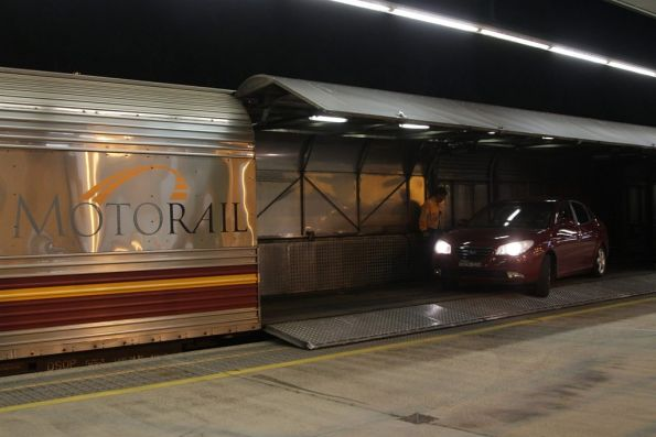 Driving a second car off the motorail wagon and onto the platform at Cairns