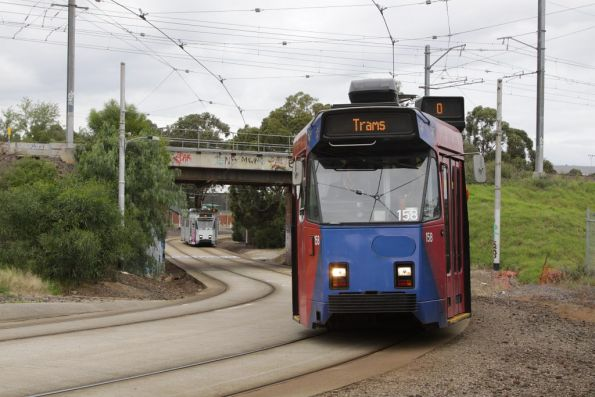 Z3.158 gets out of the way as the following route 55 tram closes in