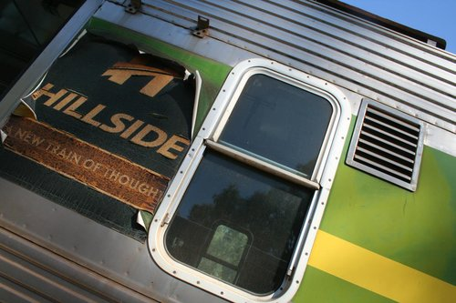 Faded 'Hillside Trains' decal on the cab of Hitachi 97M