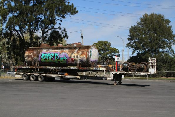 Oil tank wagon off rail at North Dynon and waiting to be trucked to the scrap yard