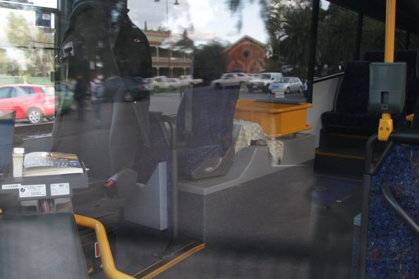 Unused mounting points for Myki equipment aboard V/Line liveried urban bus 6982AO at Castlemaine station