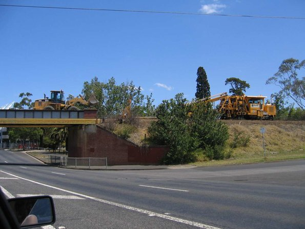 Tamper and front-end loader, working on the track over the Moorabool Street bridge in Geelong