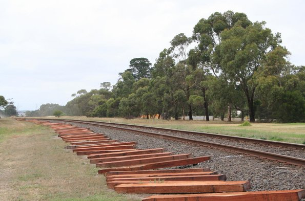 New redgum railways sleepers laid out along the tracks