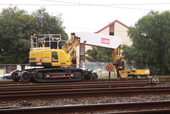 Excavator with a tie inserter attachment  stabled at Caulfield