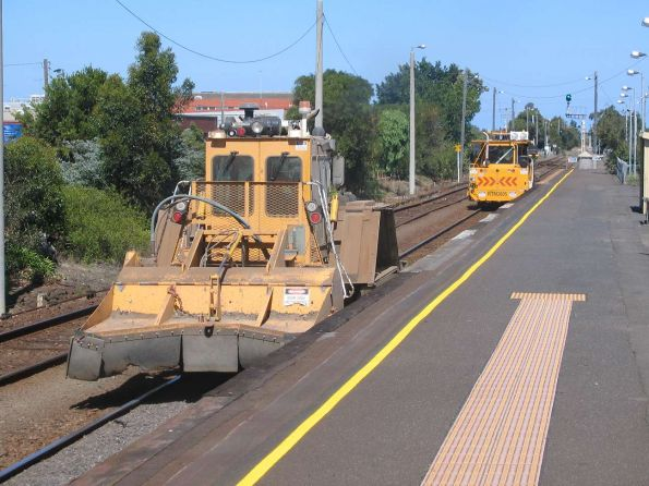 Tamper and ballast regulator passing South Geelong station