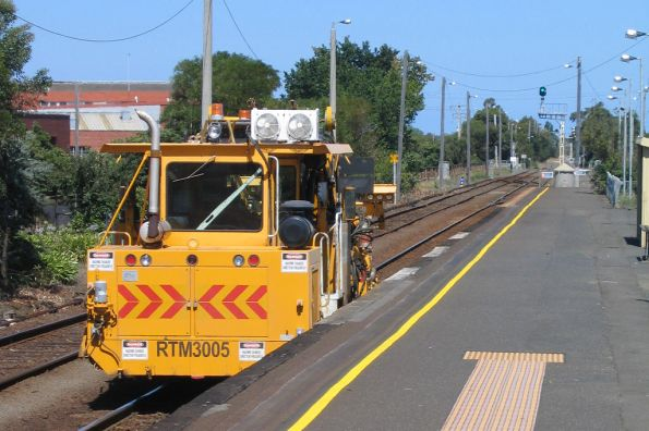 Works Infrastructure operated Pandrol Jackson 6700s tamper, coded RTM3005, on the move at South Geelong