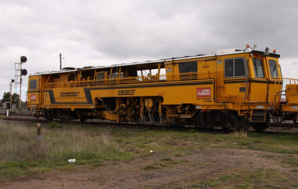 Main unit of Plasser and Theurer 09 32 CSM ballast tamper, operated by John Holland, coded 41264