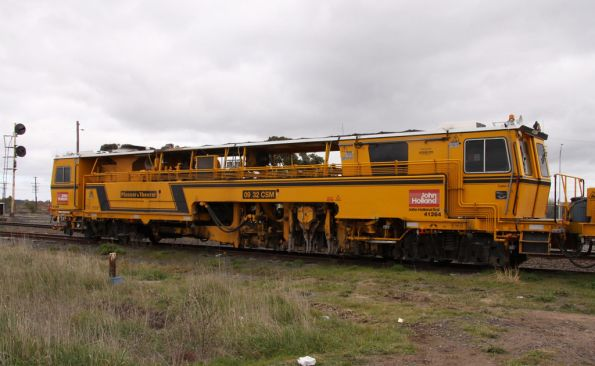 Side view of Front view of Plasser and Theurer 09 32 CSM ballast tamper
