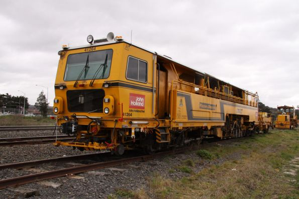 Front view of Plasser and Theurer 09 32 CSM ballast tamper