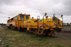 Rear view of Front view of Plasser and Theurer 09 32 CSM ballast tamper