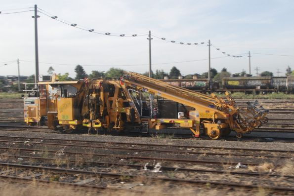 McConnell Dowell ballast tamper stabled at Tottenham Yard