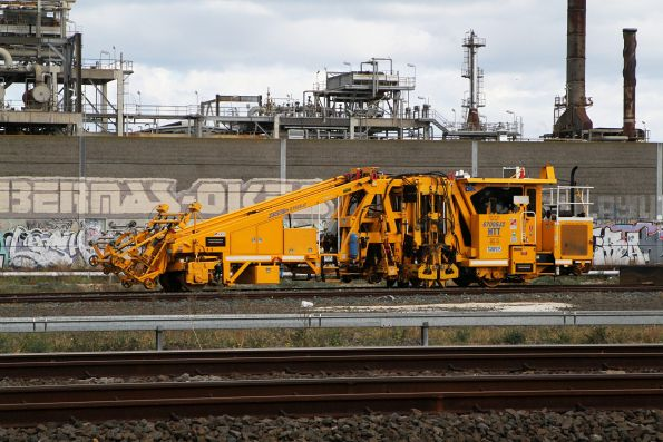 Laing O'Rourke operated Jackson 6700SJ2 ballast tamper TAMP015 at the Metro Infrastructure Siding at Paisley