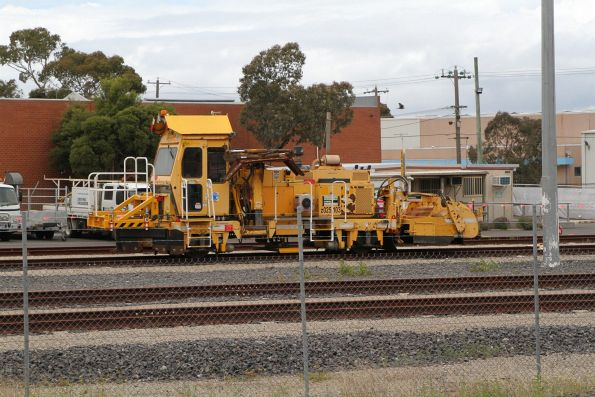 McConnell Dowell ballast tamper z025/103 parked in their depot at McIntyre